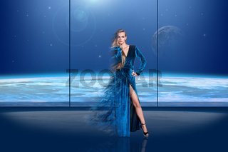 Lady in a fluttering dress in front of the window