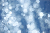 Defocused blue abstract spa background  water drops blurred in air