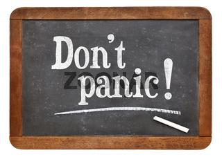 Do not panic - text on blackboard