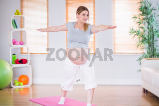 A pregnant woman doing exercise