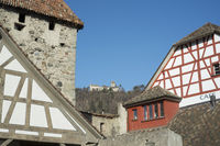 Half-timbered houses in the old town of Stein am Rhein with the castle Hohenklingen