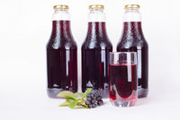 Bottles of syrup made from chokeberry and glass