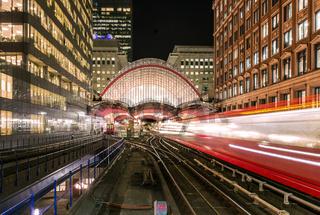 DLR trains leaving Canary Wharf Station at night, London, United Kingdom