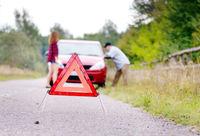 Couple near broken car