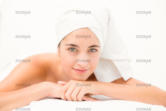 Attractive young woman on massage table