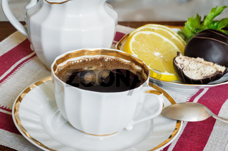 Still life : a Cup of black coffee on the table.