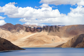 Pangong Tso Highland Lake in the Himalayas with the fantastic play of light and shadow in the surrounding mountains