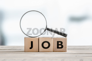 Magnifying glass on the word job