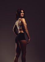 Beautiful young athletic woman, studio shot