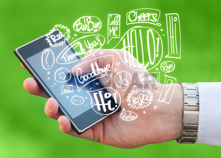 Hand holding phone with hand drawn speech bubbles