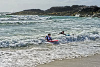 Swimmers in the surf at the Clachtoll Bay, Clatchtoll, Assynt, Scotland, United Kingdom