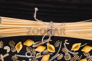Pasta on dark wooden close-up macro