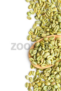 green coffee beans in wooden spoon