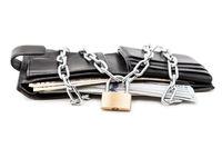 Chain padlock on full dollar currency money wallet