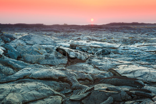 Beautiful sunset over molten cooled lava landscape in Hawaii Volcanoes National Park