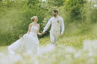 Garden Wedding holding hands
