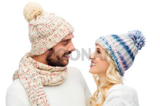 smiling couple in winter clothes