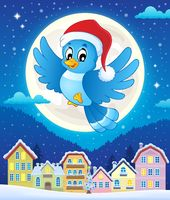 Christmas bird above town - picture illustration.