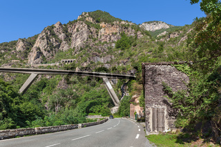Road and bridge among mountains in France.