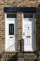 White Front Door  in a brick building,uk