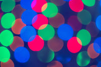 Xmas Background.  Holiday glowing Abstract Defocused Background With Blinking Lights. Blurred Bokeh. Retro Color Vintage photo