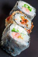 Vertical sushi in line on black background
