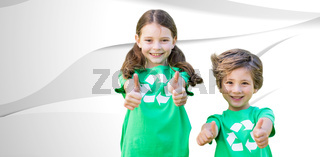 Composite image of happy siblings in green with thumbs up