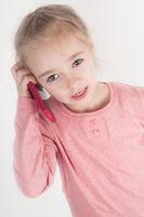 Little girl talking on mobile