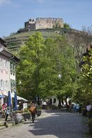 Pedestrian area in the historic town of Staufen with the castle Staufen