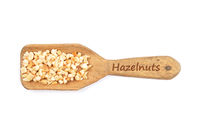 Haselnussstueckchen - Minced hazelnuts on shovel