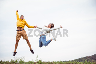 Couple jumping on a hike