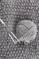Ball of wool for knitting and needles