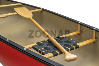 wooden paddle and canoe