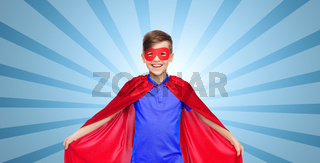 boy in red super hero cape and mask