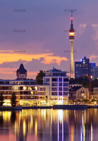 Phoenix Lake with the Florian Tower at sunset twilight, Dortmund, Ruhr area, Germany