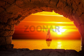 Silhouette of boat at sunset
