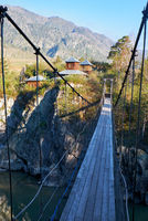 Hinged bridge to the monastery on Patmos island on river Katun in Chemal, Altai, Siberia