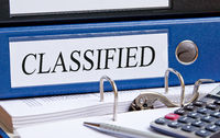Classified - blue binder in the office