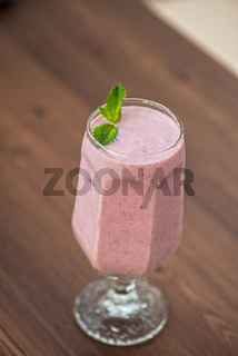 Strawberry smoothie on table