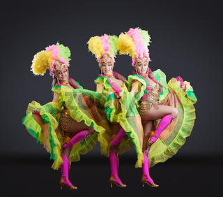 Fascinating dancers in colorful carnival costumes
