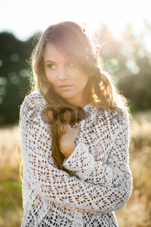 Portrait of a beautiful lady model in open field at sunset