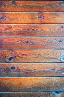 Brown wood plank wall texture background toned image
