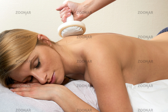 Young woman receiving a punch massage