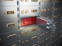Safe deposit boxes with open one safe cell.