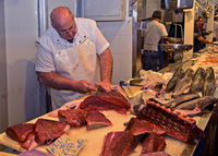Fish monger on the Cadiz fish market, Cadiz, Spain