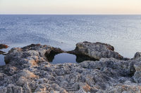 Sunset in the sea bay with rocks