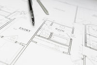 Engineer Pencil and Ruler Resting on House Plans