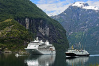 Cruise ship Silver Whisper and a local ferry in the Geirangerfjord, Geiranger, Norway