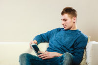 Young man with digital tablet sitting on couch