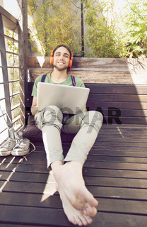 Happy man working in computer